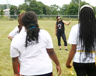 Jen Welter, the first female NFL assistant coach, talks to girls participating in the Grrridiron Girls Flag Football Camp at Glacier Field in Struthers on Tuesday. EMILY MATTHEWS | THE VINDICATOR