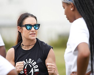 Jen Welter, the first female NFL assistant coach, talks to Donavan Gillison, 16, of Youngstown, and other girls participating in the Grrridiron Girls Flag Football Camp at Glacier Field in Struthers on Tuesday. EMILY MATTHEWS | THE VINDICATOR