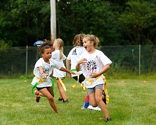 Girls participate in the Grrridiron Girls Flag Football Camp at Glacier Field in Struthers on Tuesday. EMILY MATTHEWS | THE VINDICATOR