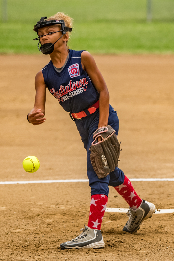 DIANNA OATRIDGE | THE VINDICATOR Austintown's Kali Ray fires a pitch during their 7-3 loss to Tallmadge in the 9-10 Little League state tournament loser's bracket game on Wednesday at Indian Hills Field in Tallmadge.