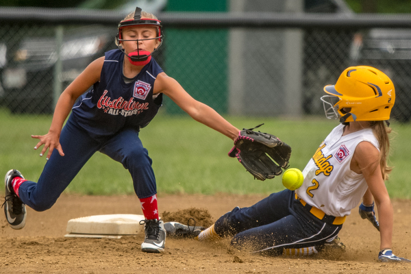 DIANNA OATRIDGE | THE VINDICATOR Austintown's Sam Severn attempts to tag Tallmadge's Danielle Sharton during their 9-10 Little League state tournament loser's bracket game on Wednesday at Indian Hills Field. Tallmadge won 7-3.
