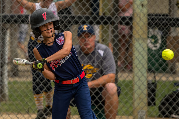 DIANNA OATRIDGE | THE VINDICATOR Austintown's Rachel Spalding keeps her eye on the ball in the batter's box during their 9-10 Little League state tournament loser's bracket game on Wednesday at Indian Hills Field. Tallmadge won 7-3.