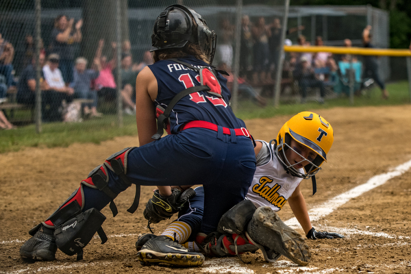 DIANNA OATRIDGE | THE VINDICATOR  Tallmadge's Marissa Charton slides into home as Austintown's Kylie Folkwein applies the tag during the loser's bracket final of the 9-10 Little League state tournament in Tallmadge. Austintown lost 7-3.