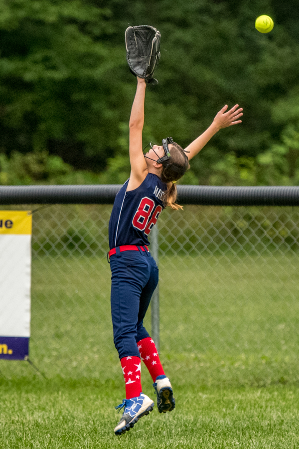 DIANNA OATRIDGE | THE VINDICATOR A deep fly ball gets past the outstretched glove of Austintown's centerfielder Gionna Rucci during the loser's bracket final of the 9-10 Little League state tournament in Tallmadge. Austintown lost 7-3.