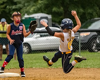 DIANNA OATRIDGE | THE VINDICATOR Austintown's Sam Severn awaits the throw to second base as Tallmadge's Bayton Justice slides in for a steal during the loser's bracket final of the 9-10 Little League state tournament in Tallmadge. Austintown lost 7-3.