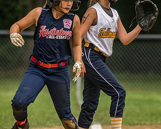 DIANNA OATRIDGE | THE VINDICATOR Austintown's Kylie Folkwein rounds third base during the loser's bracket final of the 9-10 Little League state tournament in Tallmadge. Austintown lost 7-3.