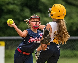 DIANNA OATRIDGE | THE VINDICATOR Austintown's Sam Severn forces out Tallmadge's Allie Gohr at second base and throws to first base for the double play during the loser's bracket final of the 9-10 Little League state tournament in Tallmadge. Austintown lost 7-3.