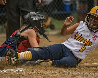 DIANNA OATRIDGE | THE VINDICATOR Austintown's Kylie Folkwein tags out Tallmadge's Gabriella Harp during the loser's bracket final of the 9-10 Little League state tournament in Tallmadge. Austintown lost 7-3.