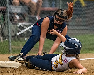 DIANNA OATRIDGE | THE VINDICATOR Austintown's Lily Stevens applies a tag on Tallmadge's Madison Birch during the loser's bracket final of the 9-10 Little League state tournament in Tallmadge. Austintown lost 7-3.