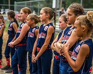 DIANNA OATRIDGE | THE VINDICATOR Austintown's 9-10 Little League softball team reacts after their 7-3 loss to Tallmadge in the loser's bracket of the state tournament at Indian Hills Field in Tallmadge.