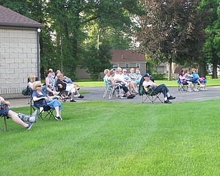 Neighbors | Jessica Harker.A crowd gathered to watch the Jim Frank Combo for the Mill Creek concert series June 28.