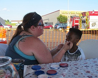 Neighbors | Jessica Harker.Jeremiah Currie got his face painted by a volunteer at the July 1 Austintown Fourth of July event.