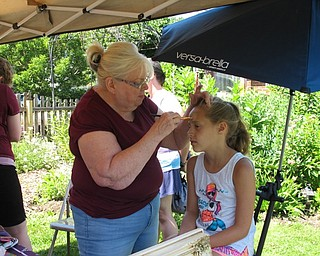 Neighbors | Jessica Harker.Elania Boyce got her face painted for free by a volunteer at the Family Fun Friday event on July 6.