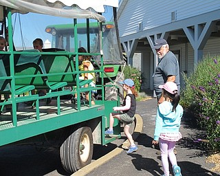 Neighbors | Jessica Harker.Children lined up to get on the tractor to go on a tour around the MetroParks farms on July 9.