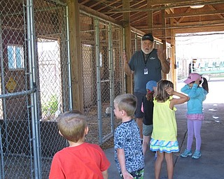 Neighbors | Jessica Harker.Instructor Bill talked about the various poultry held in one of the barns at MetroParks farms as children listened and examined the animals.