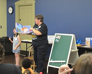 "Neighbors | Jessica Harker.Librarian Karen Saunders read ""Way down deep in the deep blue sea,"" to the group of children gathered at Family Story time July 11."