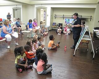 Neighbors | Jessica Harker.Librarian Karen Saunders read to the group of children gathered at the Family Story time event July 11 at the Boardman library.