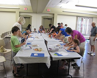 Neighbors | Jessica Harker.Children and their families participated in a craft making portion of Family Story time at the Boardman library July 11.