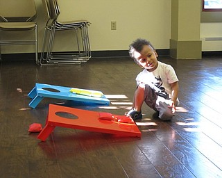 Neighbors | Jessica Harker.Glenn Barnes, age 2, played bean bag toss at the Family Story time event at the Boardman library July 11.