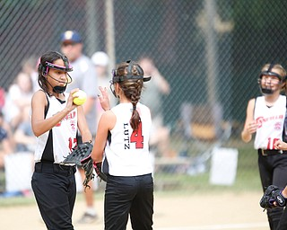 Canfield's Kyleigh Golden, left, high fives Sydney Lutz after striking out a Tallmadge player during the 10U softball state championship game at Indian Hills Field on Thursday. Canfield won 5-2. EMILY MATTHEWS | THE VINDICATOR