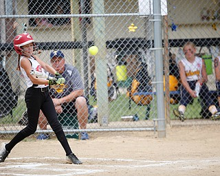 Canfield's Sam Economous hits the ball during the 10U softball state championship game against Tallmadge at Indian Hills Field on Thursday. Canfield won 5-2. EMILY MATTHEWS | THE VINDICATOR