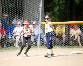 Canfield's Sam Economous takes a lead off third during the 10U softball state championship game against Tallmadge at Indian Hills Field on Thursday. Canfield won 5-2. EMILY MATTHEWS | THE VINDICATOR