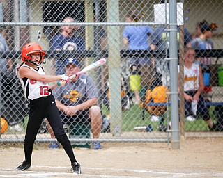 Canfield's Paris Lindgren hits the ball during the 10U softball state championship game against Tallmadge at Indian Hills Field on Thursday. Canfield won 5-2. EMILY MATTHEWS | THE VINDICATOR