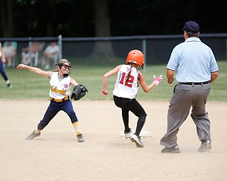 Canfield's Paris Lindgren gets safely to second before Tallmadge's Marissa Charton could tag her during the 10U softball state championship game at Indian Hills Field on Thursday. Canfield won 5-2. EMILY MATTHEWS | THE VINDICATOR