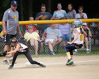 Canfield's Sam Economous catches the ball to try to get Tallmadge's Brooke Moore out during the 10U softball state championship game at Indian Hills Field on Thursday. Canfield won 5-2. EMILY MATTHEWS | THE VINDICATOR
