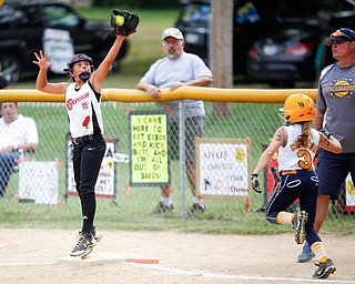 Canfield's Sydney Lutz stretches to catch the ball to get Tallmadge's Marissa Charton out during the 10U softball state championship game at Indian Hills Field on Thursday. Canfield won 5-2. EMILY MATTHEWS | THE VINDICATOR