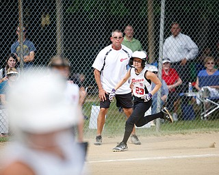 Canfield's Alexis Johnson rounds third during the 10U softball state championship game against Tallmadge at Indian Hills Field on Thursday. Canfield won 5-2. EMILY MATTHEWS | THE VINDICATOR