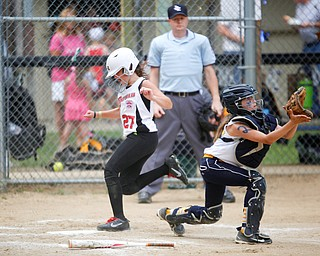Canfield's Leah Figueroa scores during the 10U softball state championship game against Tallmadge at Indian Hills Field on Thursday. Canfield won 5-2. EMILY MATTHEWS | THE VINDICATOR