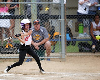 Canfield's Brooke O'Palick gets ready to swing during the 10U softball state championship game against Tallmadge at Indian Hills Field on Thursday. Canfield won 5-2. EMILY MATTHEWS | THE VINDICATOR