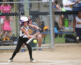 Canfield's Brooke O'Palick bunts during the 10U softball state championship game against Tallmadge at Indian Hills Field on Thursday. Canfield won 5-2. EMILY MATTHEWS | THE VINDICATOR
