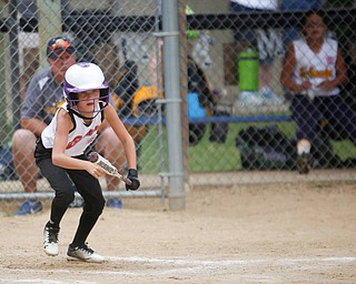Canfield's Brooke O'Palick starts to run after bunting during the 10U softball state championship game against Tallmadge at Indian Hills Field on Thursday. Canfield won 5-2. EMILY MATTHEWS | THE VINDICATOR