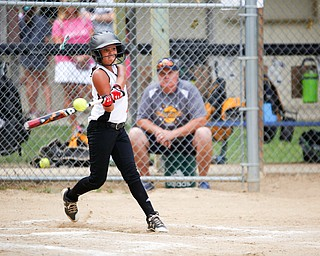 Canfield's Sydney Lutz hits the ball during the 10U softball state championship game against Tallmadge at Indian Hills Field on Thursday. Canfield won 5-2. EMILY MATTHEWS | THE VINDICATOR