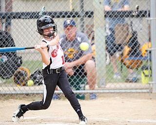 Canfield's Ava Milligan gets ready to swing during the 10U softball state championship game against Tallmadge at Indian Hills Field on Thursday. Canfield won 5-2. EMILY MATTHEWS | THE VINDICATOR