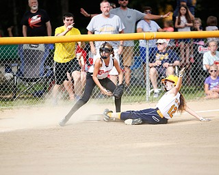 Canfield's Sam Economous gets Tallmadge's Larissa Taylor out at third during the 10U softball state championship game at Indian Hills Field on Thursday. Canfield won 5-2. EMILY MATTHEWS | THE VINDICATOR