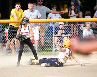 Canfield's Sam Economous smiles after getting Tallmadge's Larissa Taylor out at third during the 10U softball state championship game at Indian Hills Field on Thursday. Canfield won 5-2. EMILY MATTHEWS | THE VINDICATOR
