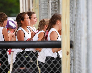 Canfield's Sydney Lutz cheers with her teammates in the dugout during the 10U softball state championship game against Tallmadge at Indian Hills Field on Thursday. Canfield won 5-2. EMILY MATTHEWS | THE VINDICATOR