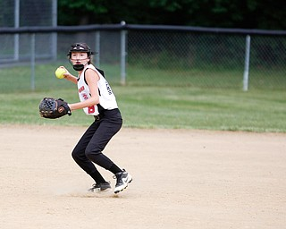 Canfield's Marina Koenig throws the ball to first during the 10U softball state championship game against Tallmadge at Indian Hills Field on Thursday. Canfield won 5-2. EMILY MATTHEWS | THE VINDICATOR
