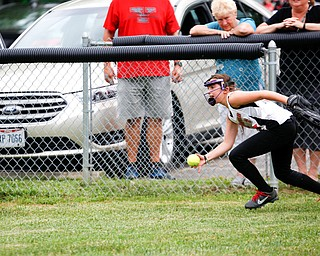 Canfield's Leah Figueroa grabs the ball in right field during the 10U softball state championship game against Tallmadge at Indian Hills Field on Thursday. Canfield won 5-2. EMILY MATTHEWS | THE VINDICATOR