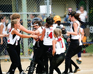 Canfield celebrates after winning the 10U softball state championship game against Tallmadge at Indian Hills Field on Thursday. EMILY MATTHEWS | THE VINDICATOR
