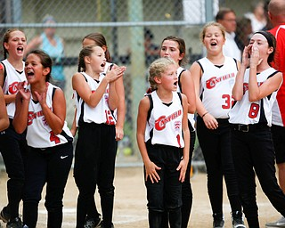 Canfield cheers to the stands after winning the 10U softball state championship game against Tallmadge at Indian Hills Field on Thursday. EMILY MATTHEWS | THE VINDICATOR