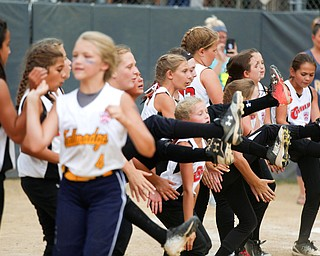Canfield cheers and congratulates runners-up Tallmadge after winning the 10U softball state championship game at Indian Hills Field on Thursday. EMILY MATTHEWS | THE VINDICATOR