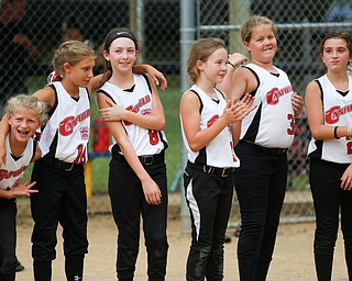 Canfield lines up after winning the 10U softball state championship game against Tallmadge at Indian Hills Field on Thursday. EMILY MATTHEWS | THE VINDICATOR