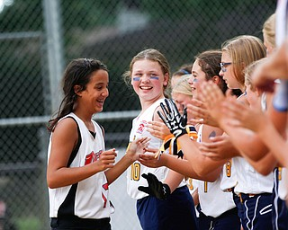 Canfield's Kyleigh Golden high-fives Tallmadge players after Canfield won the 10U softball state championship game at Indian Hills Field on Thursday. EMILY MATTHEWS | THE VINDICATOR