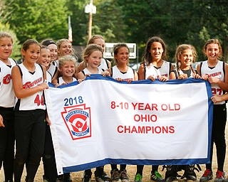 Canfield holds up their banner after winning the 10U softball state championship game against Tallmadge at Indian Hills Field on Thursday. EMILY MATTHEWS | THE VINDICATOR