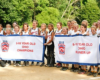 Canfield and Tallmadge hold up their banners after the 10U softball state championship game at Indian Hills Field on Thursday. EMILY MATTHEWS | THE VINDICATOR