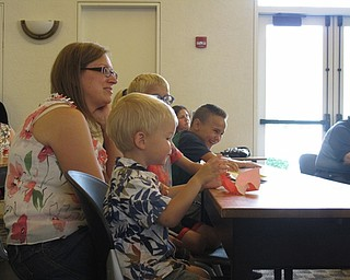 Neighbors | Jessica Harker.Nathan Skolny and his mom Kim Skolny listened to Michael Baldridge's presentation at the Paper Magic event on July 24 at the Austintown library.